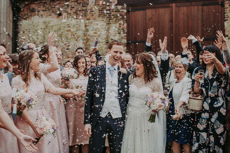Confetti Throw Rustic Charm Contemporary Pastel Barn Wedding http://www.bloomweddings.co.uk/