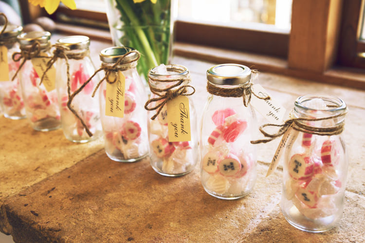 Favours Thank You Milk Bottle Twine Luggage Tag Rock Candy Sweets Relaxed Bohemian Spring Barn Wedding http://emilytylerphotography.com/
