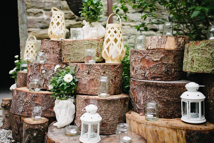 Wood slice Pile Lanterns Tealights Jars Entrance Rustic DIY Wedding at Home in the Peak District http://www.peakography.co.uk/