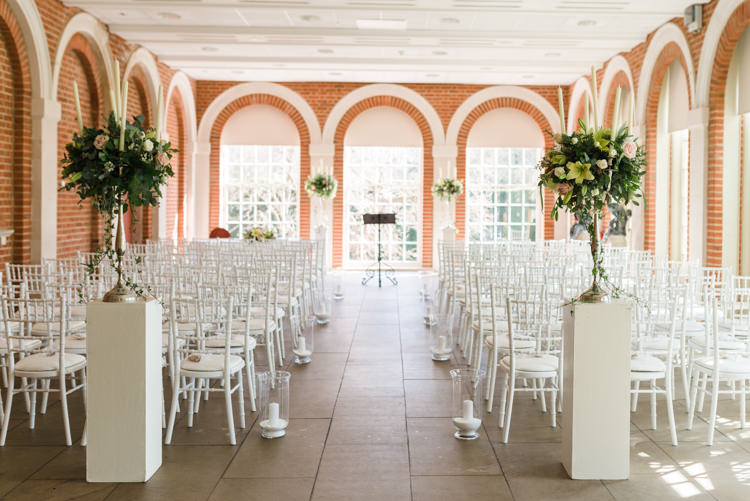 Great Fosters Ceremony Set Up White Pedestal White Chiavari Chairs Candles Classic Spring Cherry Blossom Wedding http://www.hannahmcclunephotography.com/