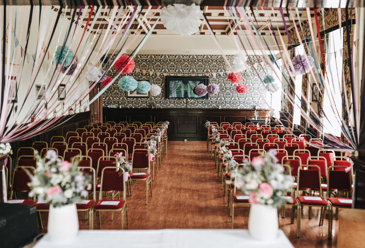 Ceremony Ribbon Backdrop Curtain Pom Poms Crafty Fun Budget Friendly Wedding https://www.pearbearphotography.com/