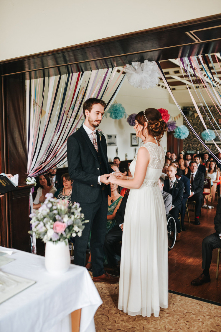 Ribbon Curtain Backdrop Ceremony Pom Crafty Fun Budget Friendly Wedding https://www.pearbearphotography.com/
