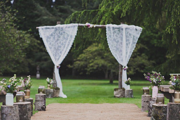 Ceremony Backdrop Aisle Flowers Logs Jars Enchanting Free-Spirited Outdoor Wedding http://www.johnelphinstonestirling.com/