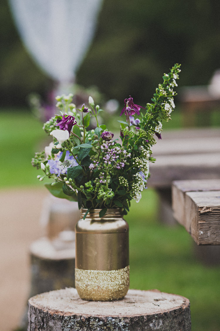 Gold Jar Glitter Flowers Log Aisle Pew Decor Enchanting Free-Spirited Outdoor Wedding http://www.johnelphinstonestirling.com/