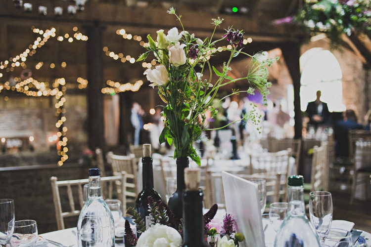 Bottle Flowers Decor Enchanting Free-Spirited Outdoor Wedding http://www.johnelphinstonestirling.com/