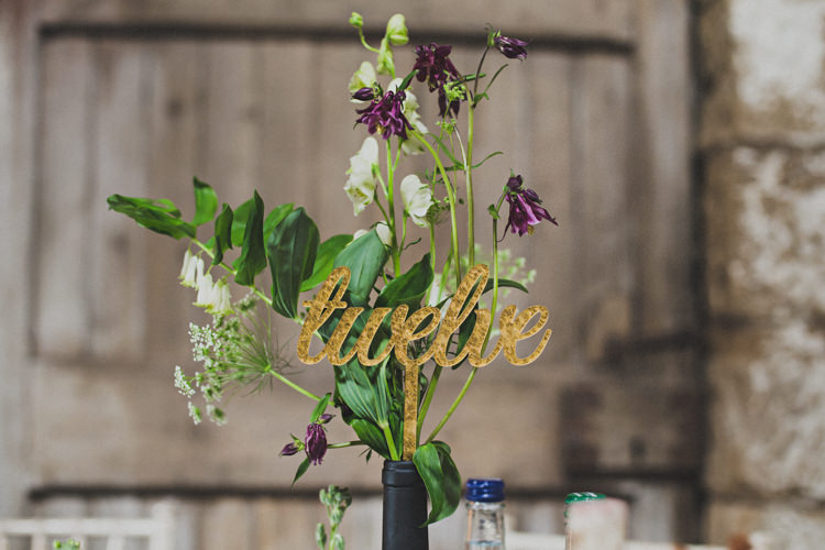 Gold Table Names Numbers Enchanting Free-Spirited Outdoor Wedding http://www.johnelphinstonestirling.com/