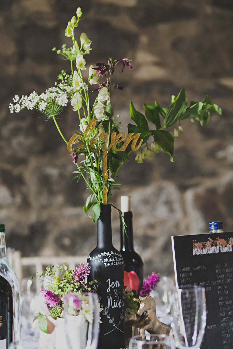 Chalk Black Painted Bottle Flowers Centrepieces Decor Table Enchanting Free-Spirited Outdoor Wedding http://www.johnelphinstonestirling.com/