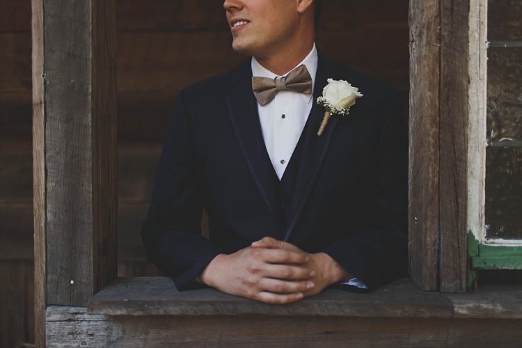 Groom Rose Button Hole Navy Bow Tie Glam Twinkling Ranch Wedding Florida https://www.stacypaulphotography.com/