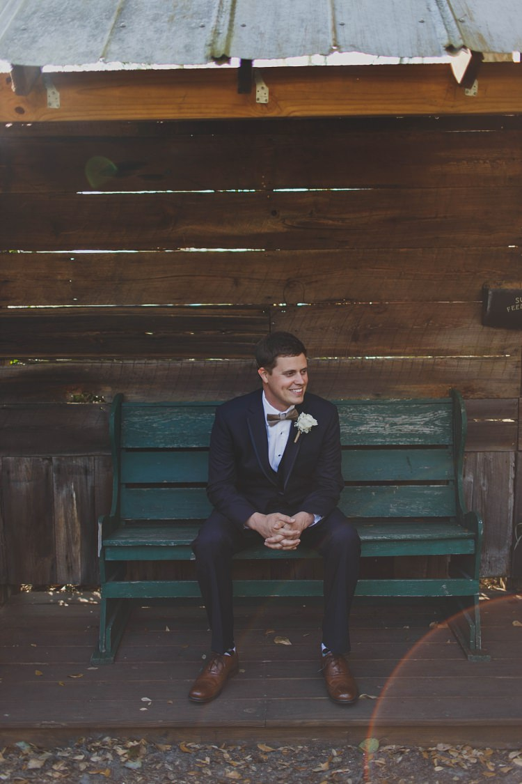 Groom Sitting Bow Tie Navy Glam Twinkling Ranch Wedding Florida https://www.stacypaulphotography.com/