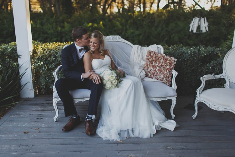 Bride Groom Kiss Sitting Sofa Glam Twinkling Ranch Wedding Florida https://www.stacypaulphotography.com/