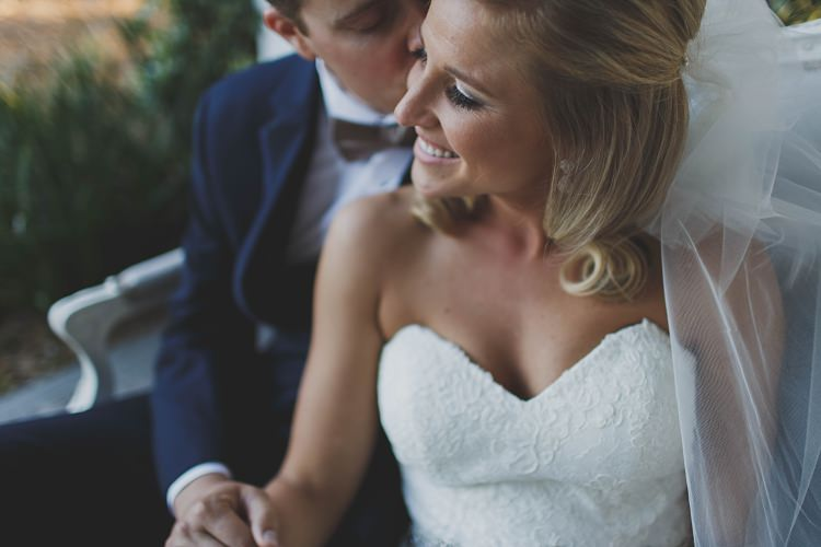 Bride Groom Sitting Kiss Cheek Glam Twinkling Ranch Wedding Florida https://www.stacypaulphotography.com/