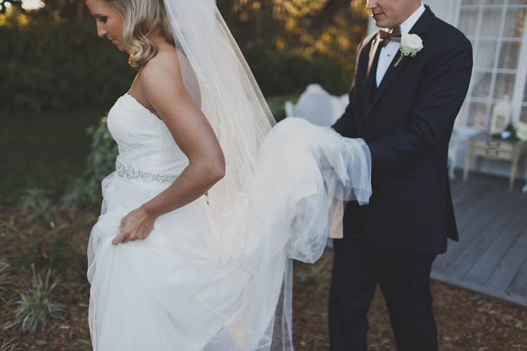 Groom Holding Dress Bride Glam Twinkling Ranch Wedding Florida https://www.stacypaulphotography.com/