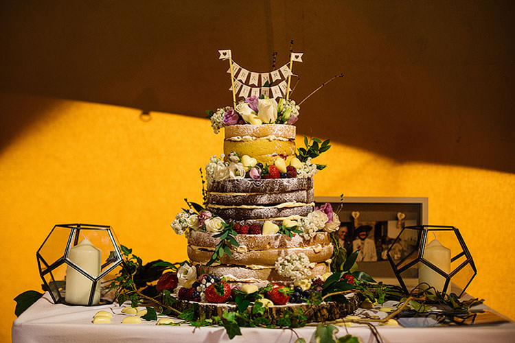 Naked Sponge Cake Layer Bunting Topper Charming Natural Countryside Tipi Wedding http://www.pauljosephphotography.co.uk/