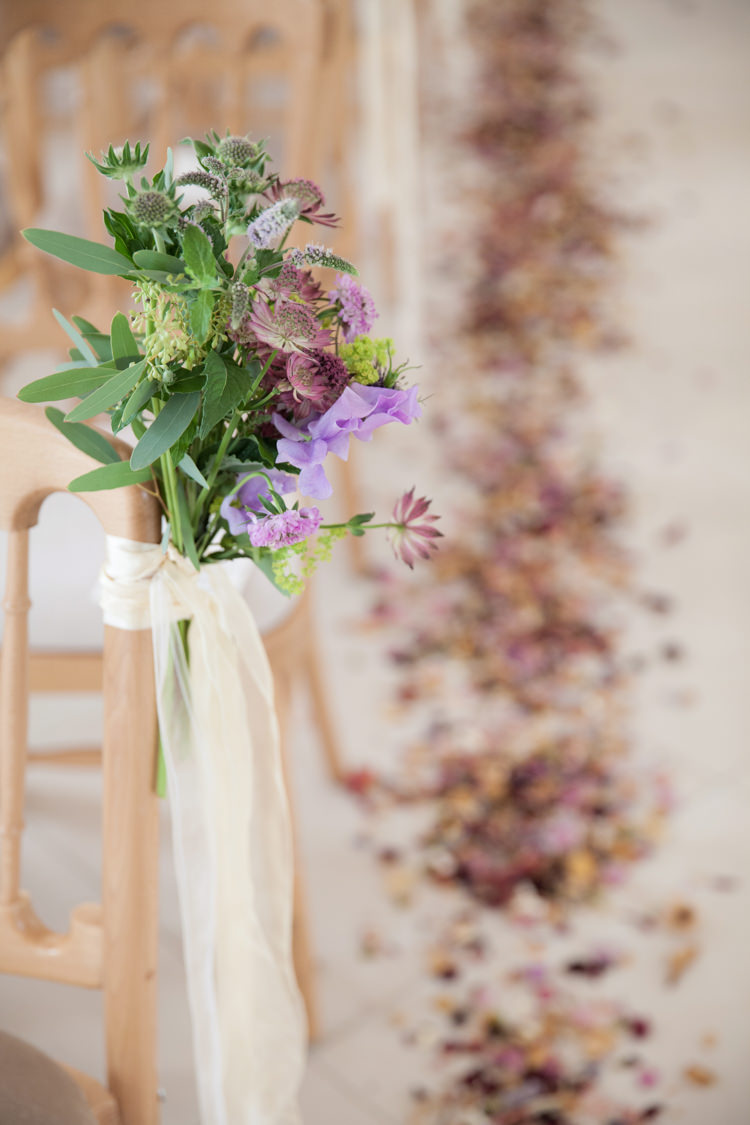 Chair Pew End Aisle Flowers Ribbon Nigella Cornflowers Sweet Peas Stocks Scabious Rosemary Mint Purple Summer Festival Country Estate Wedding http://kerryannduffy.com/