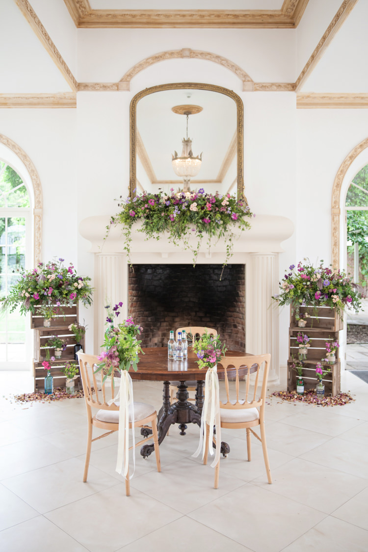 Ceremony Flowers Crates Chairs Table Fireplace Mantle Summer Festival Country Estate Wedding http://kerryannduffy.com/