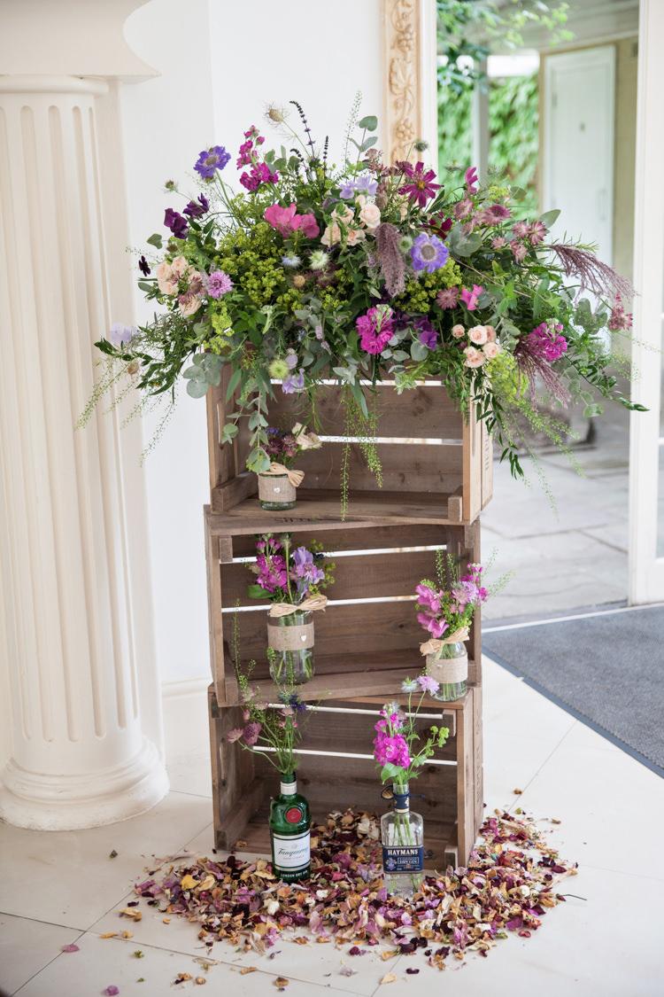 Crate Flowers Purple Jars Bottles Nigella Cornflowers Sweet Peas Stocks Scabious Rosemary Mint Summer Festival Country Estate Wedding http://kerryannduffy.com/