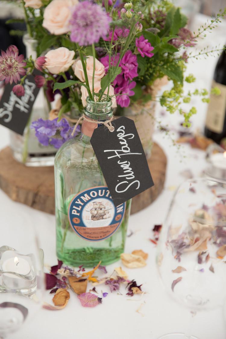 Gin Bottle Flowers Summer Festival Country Estate Wedding http://kerryannduffy.com/
