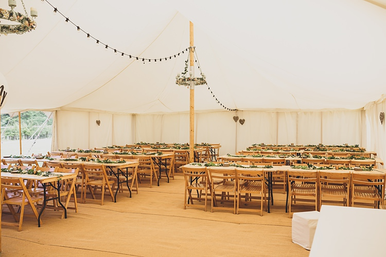 Marquee Festoon Lights Long Tables Big Stylish Outdoors Glamping Wedding https://www.jessyarwood.co.uk/