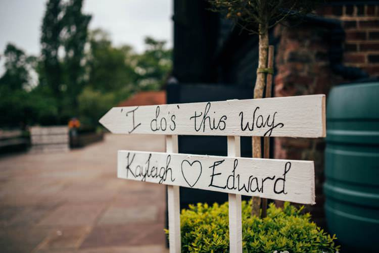Rustic Painted Sign Post Colourful Hand Made Rustic Barn Flower Filled Wedding http://www.threeflowersphotography.co.uk/