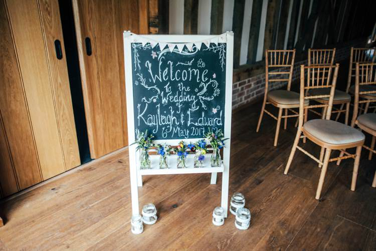 Chalk Black Board Welcome Sign Colourful Hand Made Rustic Barn Flower Filled Wedding http://www.threeflowersphotography.co.uk/