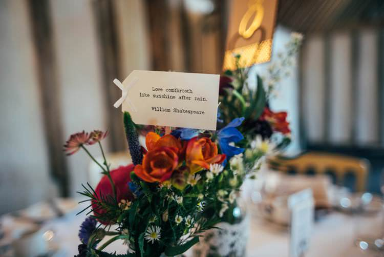 Table Name Quotes Flowers Colourful Hand Made Rustic Barn Flower Filled Wedding http://www.threeflowersphotography.co.uk/