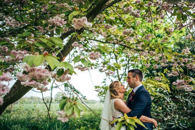 Cherry Blossom Portraits Colourful Hand Made Rustic Barn Flower Filled Wedding http://www.threeflowersphotography.co.uk/