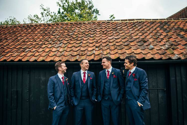 Navy Blue Suits Red Ties Groomsmen Colourful Hand Made Rustic Barn Flower Filled Wedding http://www.threeflowersphotography.co.uk/