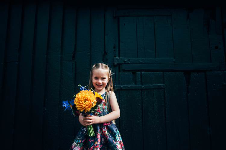 Floral Flower Girl Dress Colourful Hand Made Rustic Barn Flower Filled Wedding http://www.threeflowersphotography.co.uk/