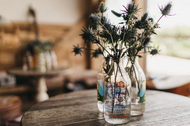 Vintage Milk Bottle Flowers Eclectic Cool Glam Barn Wedding http://luciusfoxphotography.com/ http://www.stevebridgwoodphotography.co.uk/