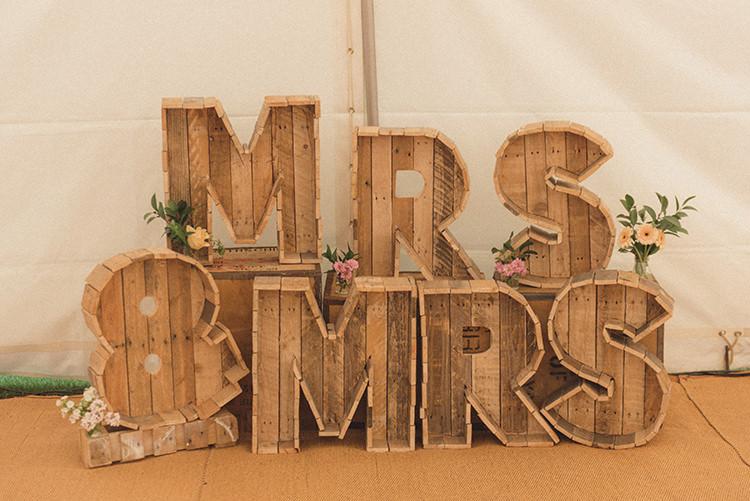 Letter Lights Mrs Mrs DIY Rustic Woodland Marquee Wedding http://www.rebeccadouglas.co.uk/