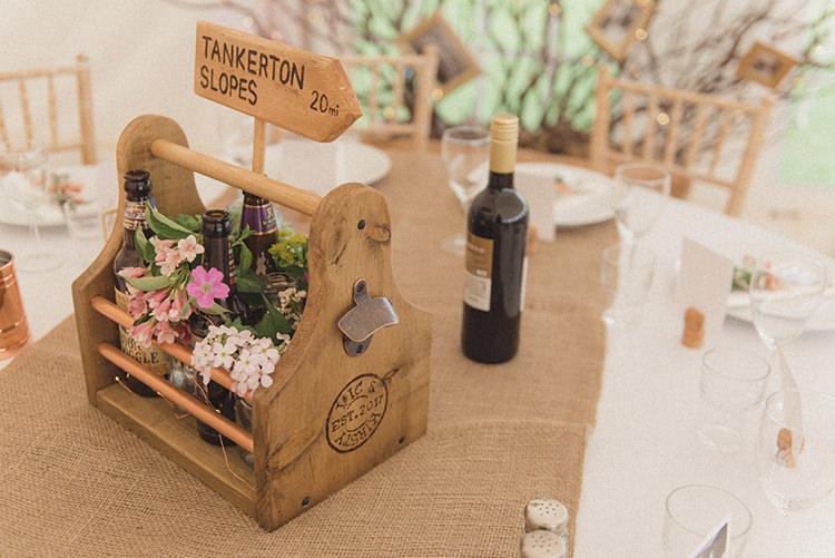 Table Centrepieces Wooden Crates Sign Post Table Names Flowers Beer Bottles Hessian DIY Rustic Woodland Marquee Wedding http://www.rebeccadouglas.co.uk/