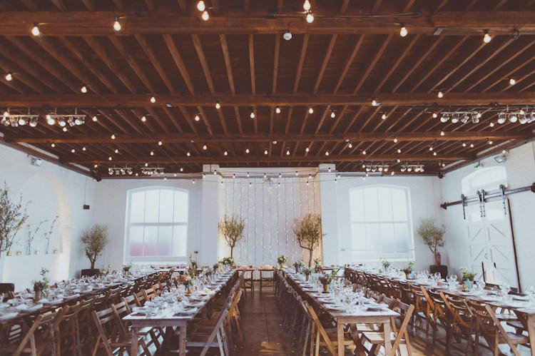 Festoon Lights Fairy Rustic Tables Urban Industrial Chic Warehouse Wedding http://sashaweddings.co.uk/