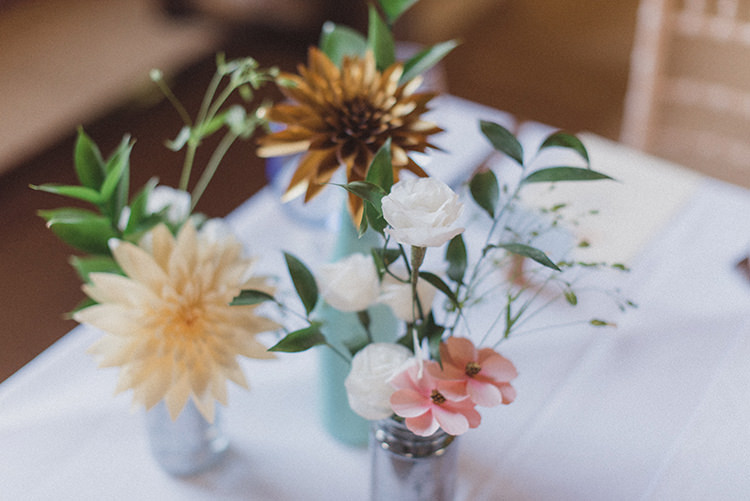 Paper Flowers DIY Bottles Centrepiece Relaxed Home Made Love Barn Wedding http://www.rebeccadouglas.co.uk/