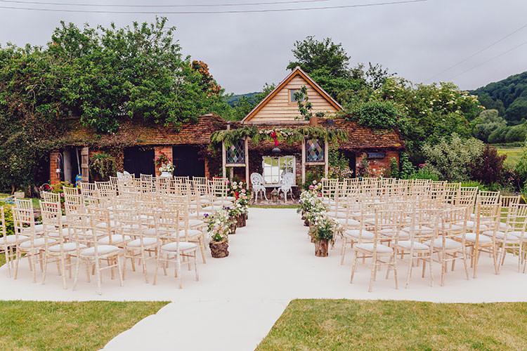 Ceremony Setup White Carpet Aisle Log Floral Arrangements Humanist Hand Made Orchard Garden Wedding http://www.curiousrosephotography.com/