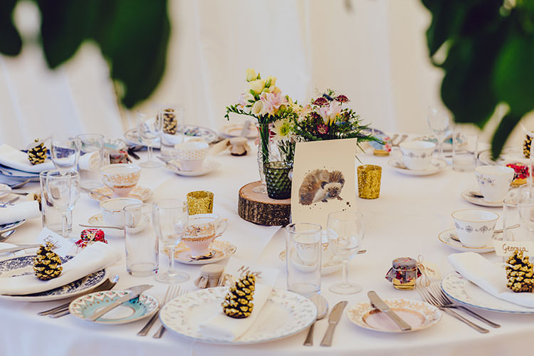Table Setting Pine Cones Glitter Watercolour Number Centre Log Candles Floral Mismatched Crockery Humanist Hand Made Orchard Garden Wedding http://www.curiousrosephotography.com/