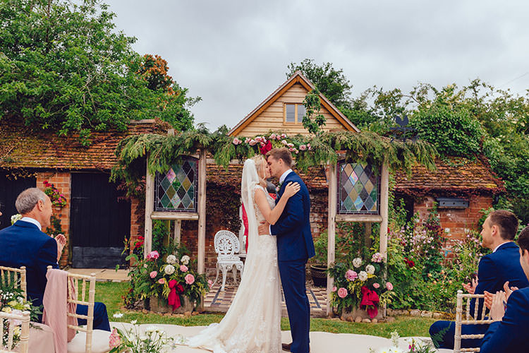 Ceremony Backdrop Floral Foliage Bride Bridal Maggie Sottero Dress Gown Veil Hair Vine French Connection Groom Suit Humanist Hand Made Orchard Garden Wedding http://www.curiousrosephotography.com/