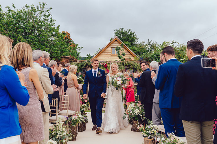 Aisle Log Arrangements Floral Bride Bridal Maggie Sottero Dress Gown Hair Vine French Connection Groom Suit Humanist Hand Made Orchard Garden Wedding http://www.curiousrosephotography.com/