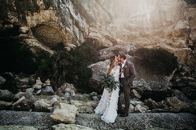 Bride Groom Kiss Rocks Beach Whimsical Greenery Wedding Ideas Sea http://eglejo.lt/