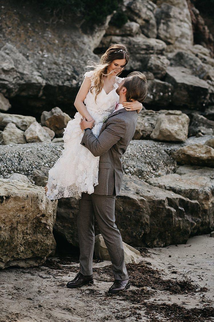 Bride Lift Groom Beach Rocks Whimsical Greenery Wedding Ideas Sea http://eglejo.lt/