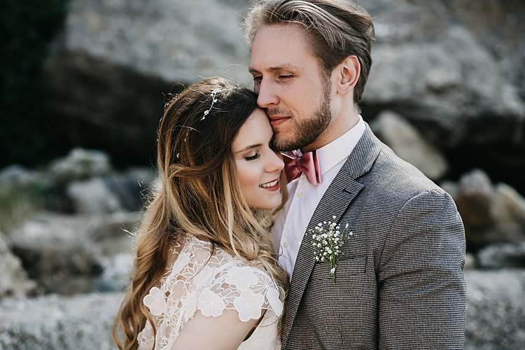 Bride Groom Embrace Beach Rocks Whimsical Greenery Wedding Ideas Sea http://eglejo.lt/