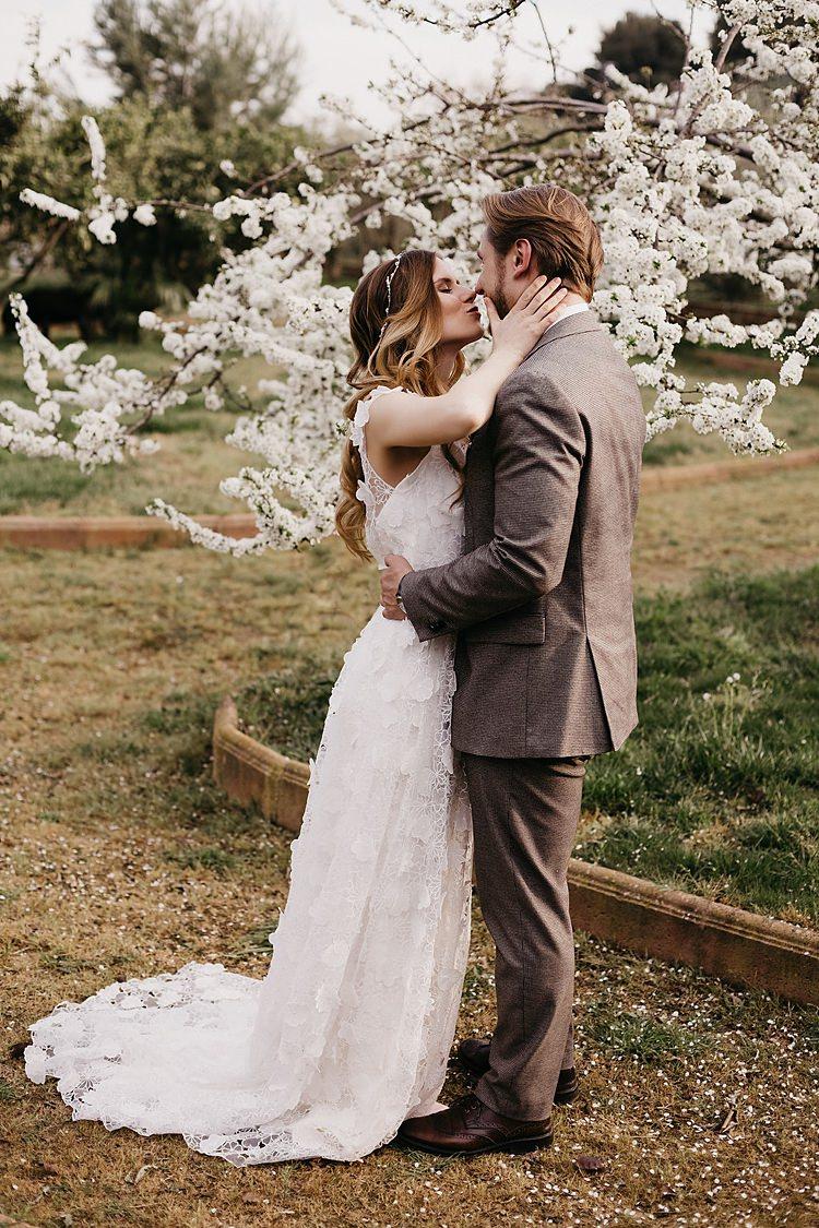 Bride Groom Kiss Blossom Whimsical Greenery Wedding Ideas Sea http://eglejo.lt/