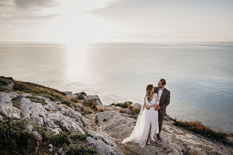 Bride Groom Embrace Rocks Beach Whimsical Greenery Wedding Ideas Sea http://eglejo.lt/