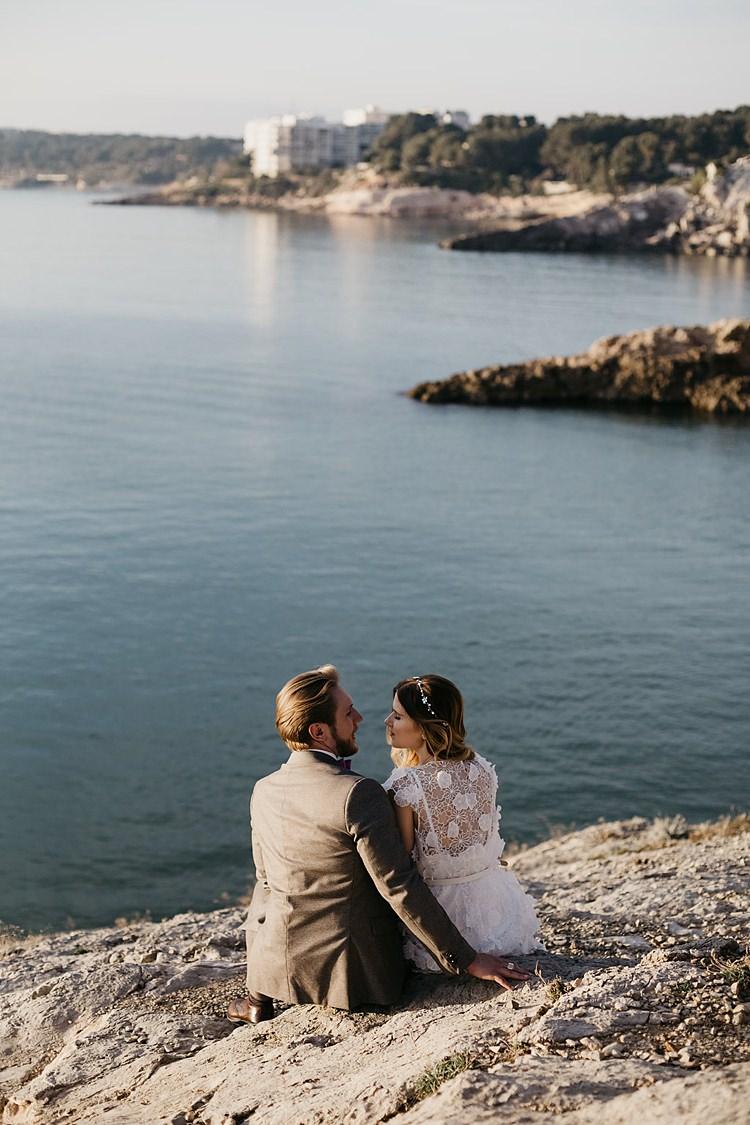 Bride Groom Beach Cliff Sitting Whimsical Greenery Wedding Ideas Sea http://eglejo.lt/