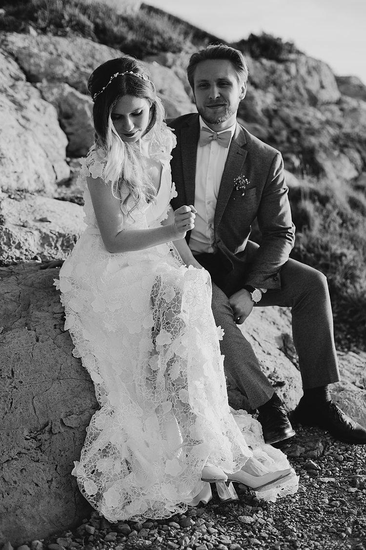 Bride Groom Sitting Cliff Whimsical Greenery Wedding Ideas Sea http://eglejo.lt/