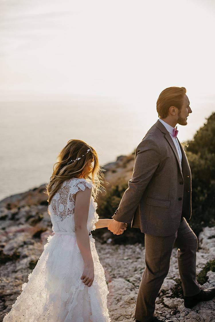 Bride Groom Climbing Cliff Whimsical Greenery Wedding Ideas Sea http://eglejo.lt/