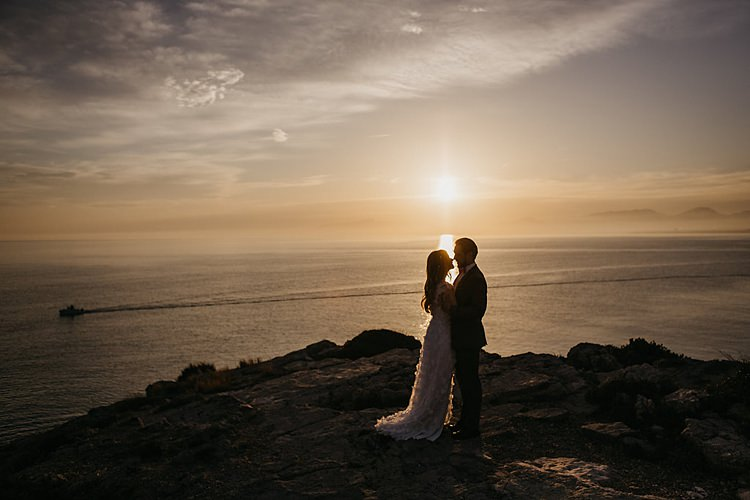 Bride Groom Cliff Sunset Whimsical Greenery Wedding Ideas Sea http://eglejo.lt/
