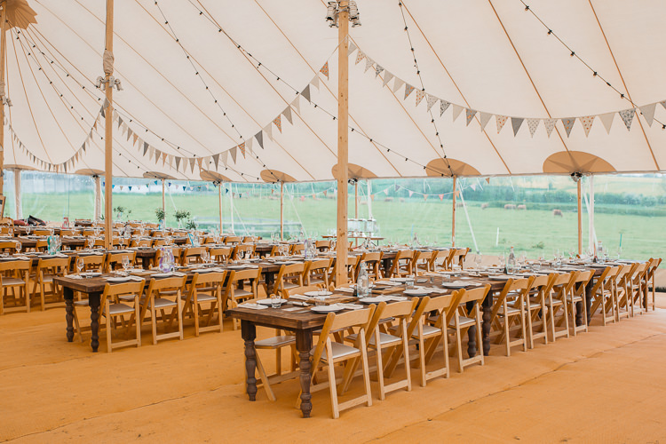 Sperry Tent wooden Chairs Table Rustic Bunting Festoon Lighting Outdoor Farm Wedding 1970s Dress https://www.magdak.co.uk/