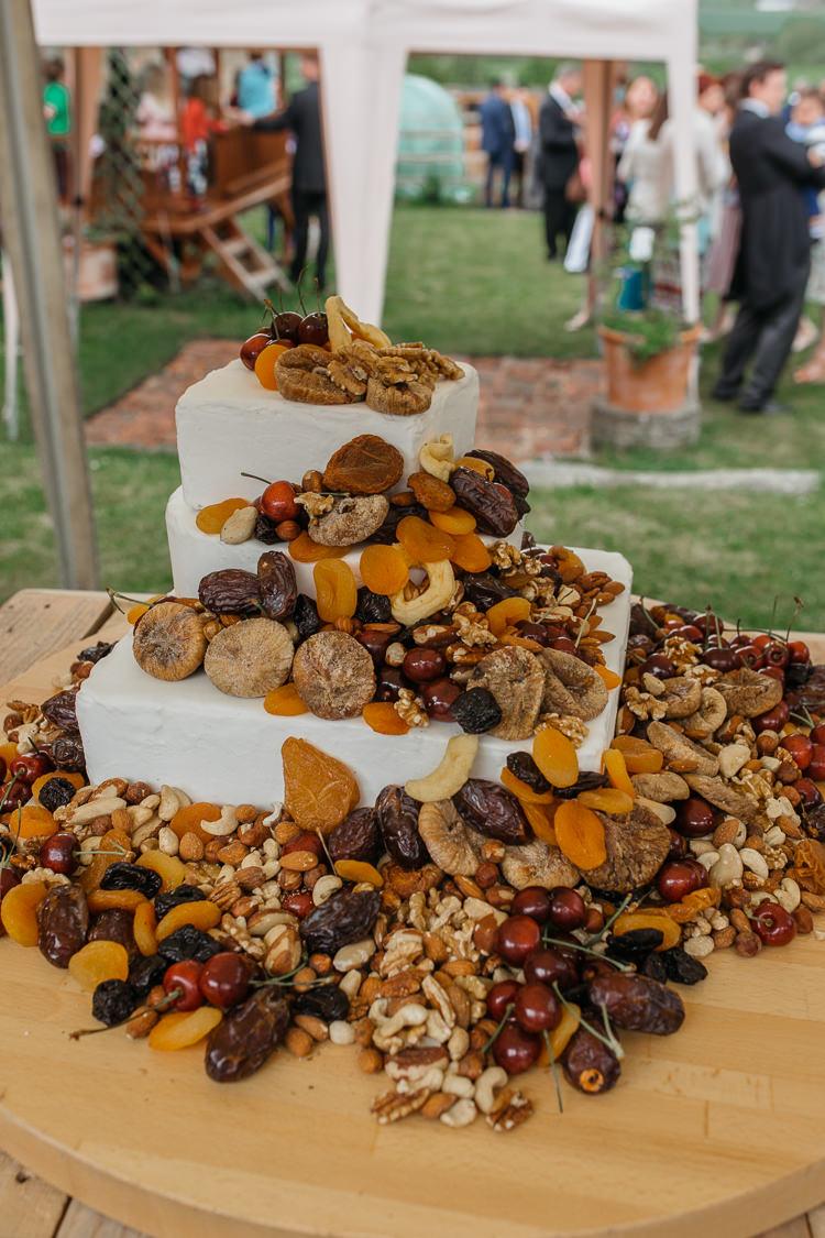 Cake Table Dried Fruit Cascade Outdoor Farm Wedding 1970s Dress https://www.magdak.co.uk/
