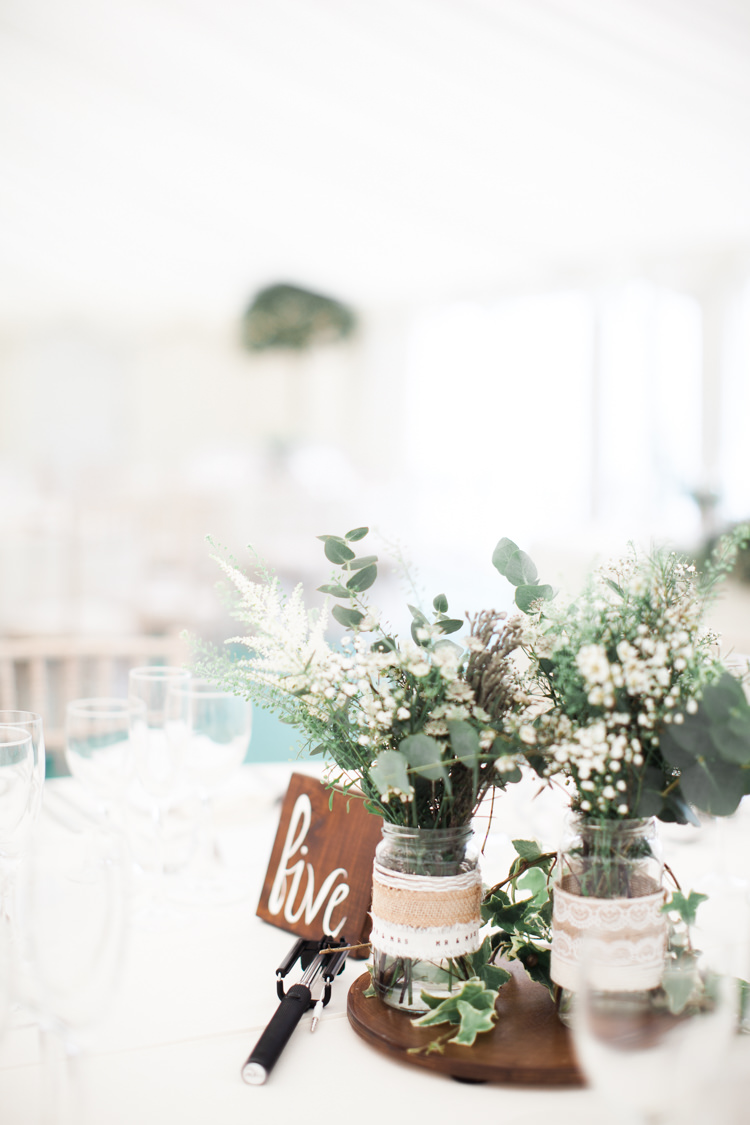 Log Centrepiece Wood Jars Hessian Lace Flowers Greenery Beautifully Authentic Rustic Country House Wedding https://www.nikkismoments.com/