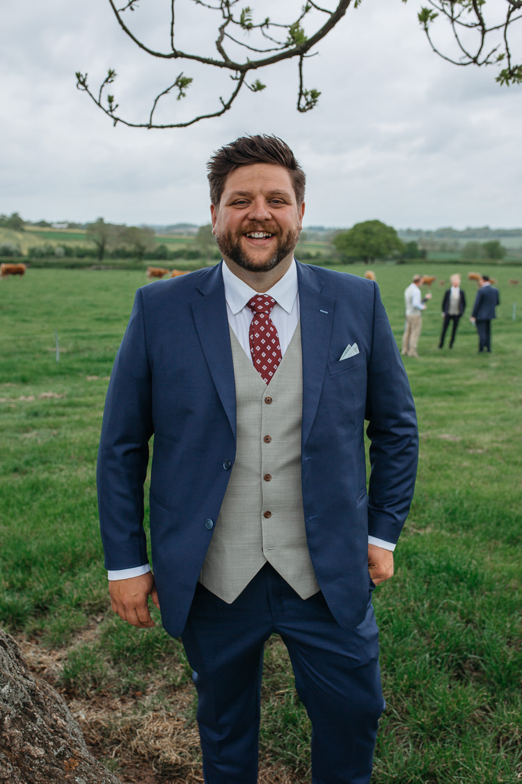 Bespoke Groom Navy Suit Grey Waistcoat Red Tie Outdoor Farm Wedding 1970s Dress https://www.magdak.co.uk/